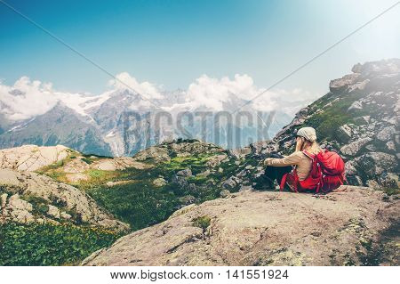 Woman Traveler with backpack relaxing with mountains serenity view Travel Lifestyle concept hiking adventure summer vacations