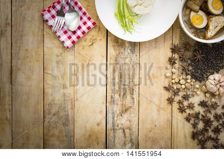 Thai food Kai-Pa-lo with rice dish and spices on wooden background.1