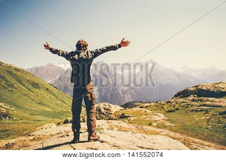 Traveler Man hands raised hiking Travel Lifestyle concept beautiful mountains landscape on background adventure vacations outdoor rear view