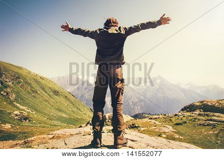 Happy Man hands raised mountaineering Travel Lifestyle concept mountains landscape on background adventure vacations outdoor