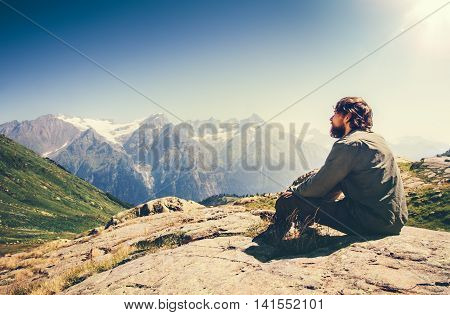 Man relaxing Travel Lifestyle concept beautiful mountains landscape on background adventure vacations outdoor