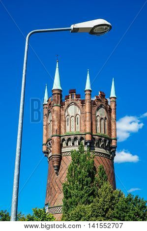 Water tower with lantern in Rostock (Germany) with blue sky.