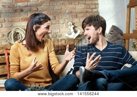 Young couple shouting at home. Relationship difficulties.
