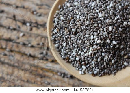 close up black and white chia seeds against on wooden spoondry organic high energy and vitamine