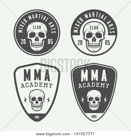 Set of vintage mixed martial arts or fighting club logos emblems badges labels marks and design elements. Retro graphic art. Vector Illustration. Graphic Art