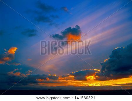 Sunset over a dark landscape. Useful as background for your projects.