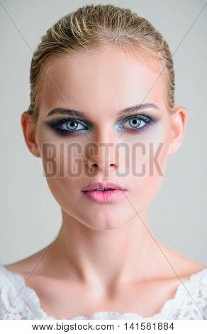 Studio beauty shot: closeup portrait of a beautiful young girl