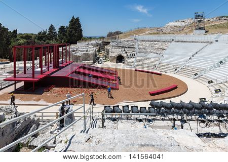 SIRACUSA ITALY - MAY 18: Workers preparing a stage for a performance in the old Greek theatre of Syracusa on May 18 2016 at the island Sicily Italy