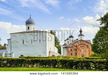Architecture panoramic view - Assumption church Paraskeva Pyatnitsa church and St. Nicholas cathedral at Yaroslav's Courtyard in Veliky Novgorod Russia