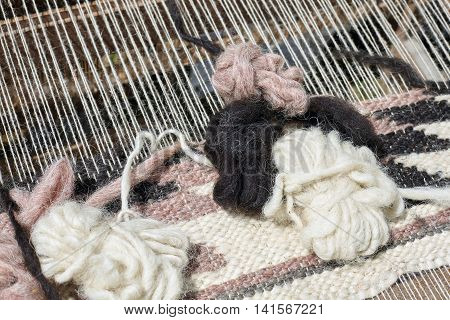 A closeup image of an old weaving Loom details.