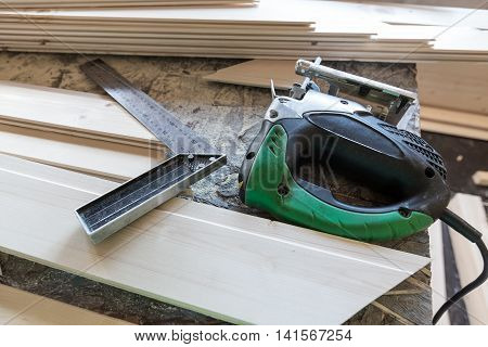 Fretsaw, Metal Ruller And Tongue And Groove Boards On Working Place