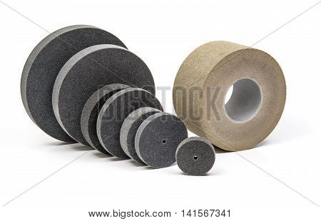 Professional Industrial grinding and polishing wheels on white background