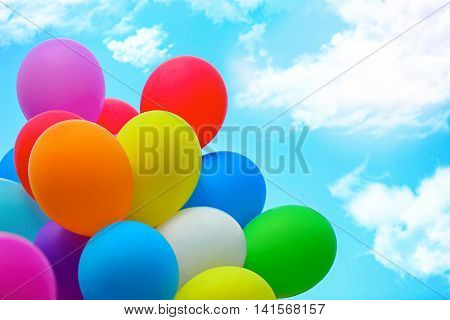 Multicoloured balloons on sky background
