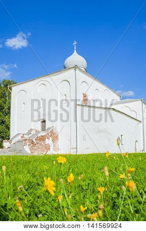 Architecture summer landscape - Assumption Church at the Yaroslav Courtyard at summer sunny day in Veliky Novgorod Russia