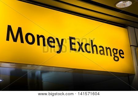 money exchange / currency exchange sign board at airport
