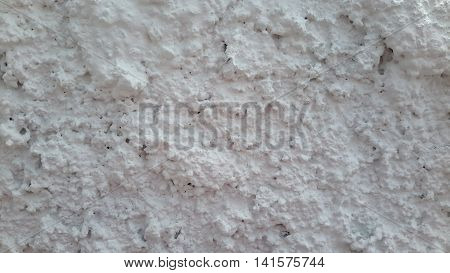 close up of white stucco on a museum wall in Songkhla, Thailand