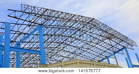 network of steel roof and support beams at a stadium construction site, Songkhla, Thailand