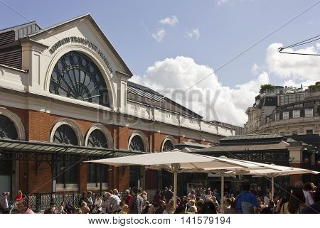 LONDON, UNITED KINGDOM - SEPTEMBER 12 2015: People in Covent Garden square facing the London Transport Museum