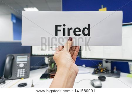 business woman hold a getting fired paper in hand