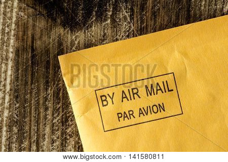 Yellow envelope with black air mail stamp