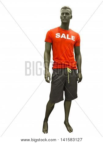Male mannequin dressed in shorts and red t-shirt on which sale is written.