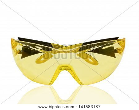 Yellow protective spectacles isolated on white background.