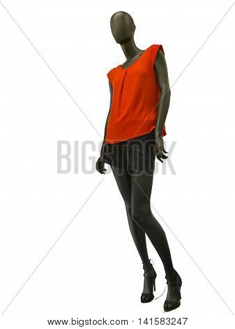 Female mannequin dressed in shorts and red top isolated on white background. No brand names or copyright objects.