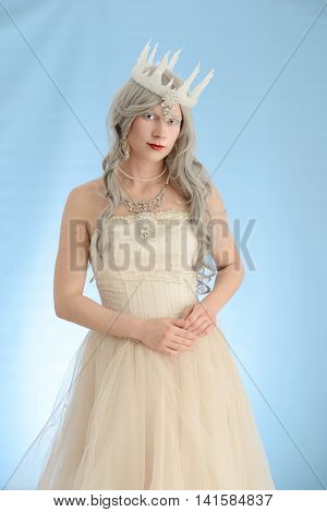 snow queen with grey hair and ice crown
