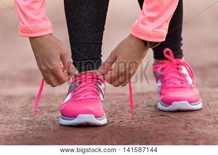 Sport Woman Tying Shoe Laces