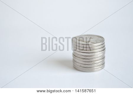 Single stack of U.S. nickels lower right.