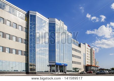A large modern office building of the Russian bank VTB 24 and parking in front of the building. City Cheboksary Chuvash Republic Russia. 08/07/2016