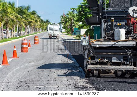 Pavement Truck Laying Fresh Asphalt