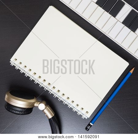 Headphone Keyboard and for blank book for music writing. Song writing equipment in vintage tone.
