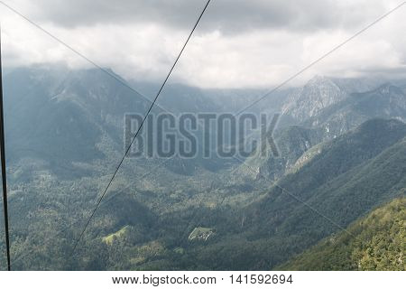 Photo shows mountains landscape view from cableway in summer.