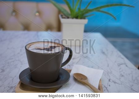 hot fresh coffee in cup on marble table on wooden tray and wooden spoon and white saucer cappuccino coffee mocha coffee espresso coffee latte coffee