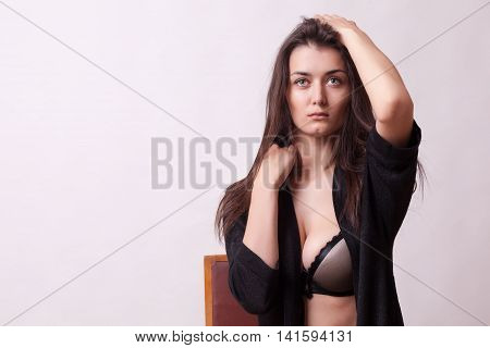 Gorgeous young woman posing in studio on grey background. Studio photo. Fashion and sensuality