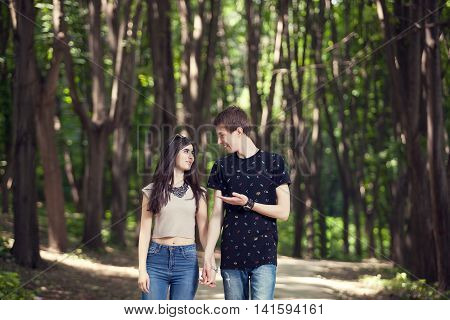 Couple Walking And Smiling Each Other