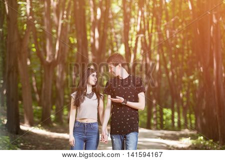 Couple Walking And Smiling Each Other With A Soft Light Leack From Above