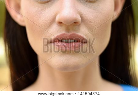 Close Up On The Parted Lips Of A Thin Woman