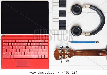 Computer Music producing equipment, Song writing equipments on wooden table.