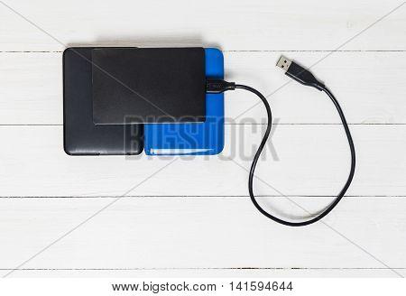 USB External Hard disks on wooden background