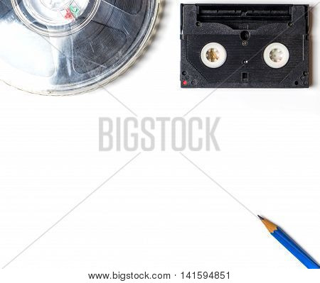 Movie Film Roll and Video Tape isolated on white with copy space.