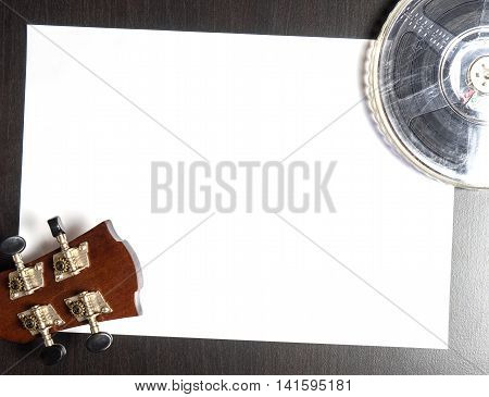 Guitar Head with Film Roll on white paper with space
