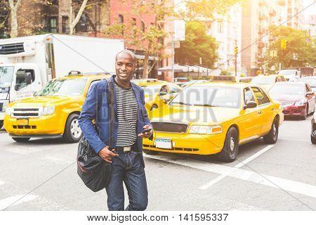 Black Man Crossing A Street In New York.