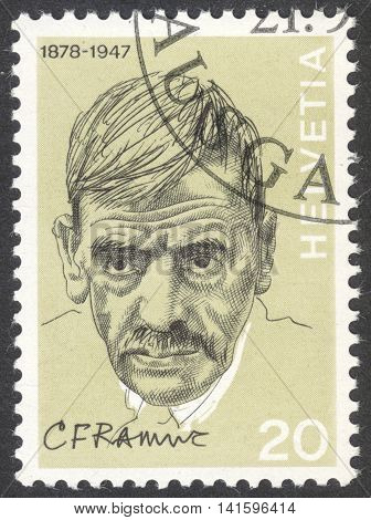 MOSCOW RUSSIA - CIRCA APRIL 2016: a post stamp printed in SWITZERLAND shows a portrait of Charles Ferdinand Ramuz the series