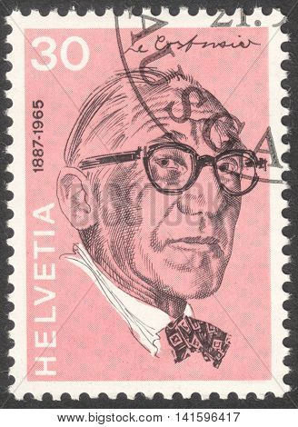 MOSCOW RUSSIA - CIRCA APRIL 2016: a post stamp printed in SWITZERLAND shows a portrait of Charles Edouard Jeanneret Gris the series