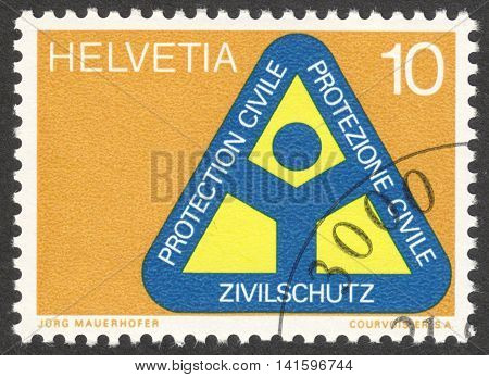 MOSCOW RUSSIA - CIRCA APRIL 2016: a post stamp printed in SWITZERLAND dedicated to the Civil Protection Organisation circa 1972