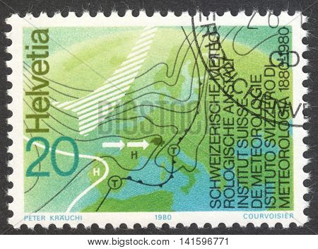 MOSCOW RUSSIA - CIRCA MAY 2016: a post stamp printed in SWITZERLAND dedicated to the Swiss meteorological office centenary circa 1980