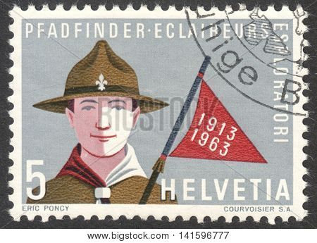 MOSCOW RUSSIA - CIRCA MAY 2016: a post stamp printed in SWITZERLAND dedicated to the 50th Anniversary of Swiss Boy Scouts circa 1963