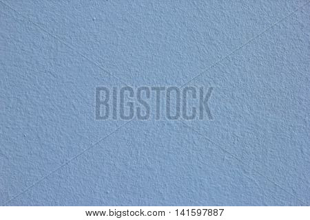 texture of blue rough plastered painted wall